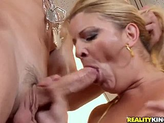 Natural titted mature with fully pierced pussy